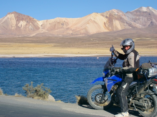 Motorcycle Rider by Lake in Bolivia