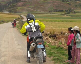 Girls Watching Riders in Peru