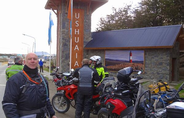 Riders at entrance to Ushuaia Argentina