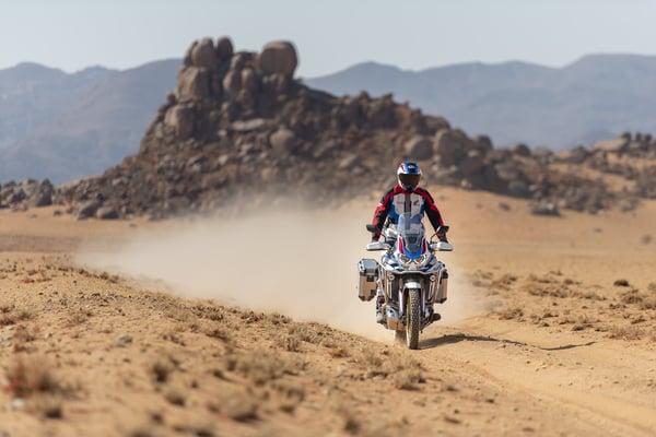 Rider on a brand new 2020 Honda Africa Twin riding through the desert