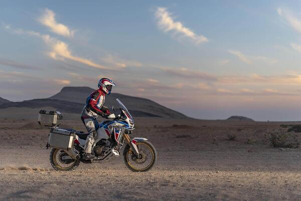 Rider in the desert at sunset on a 2020 Honda Africa Twin