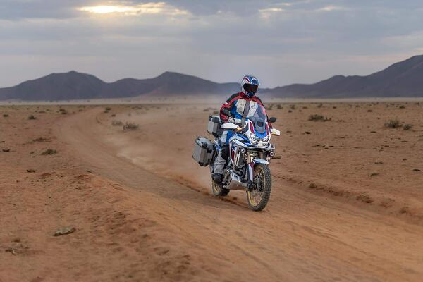Rider kicking up dust as he rides the 2020 Honda Africa Twin in the desert.