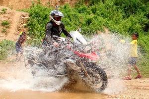 Motorcycle Splashing Kids Laos