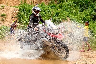 Motorcycle Splashing Kids Laos