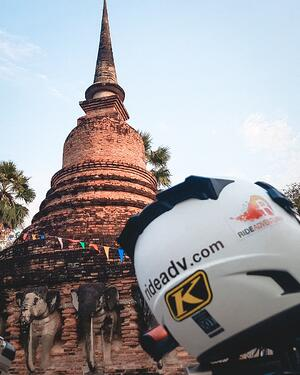 Our Logo and helmet with a Buddhist Temple behind it.