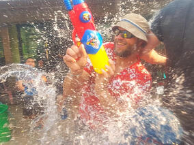 Eric getting shot with waterguns during an epic water battle during Songkran in Thailand