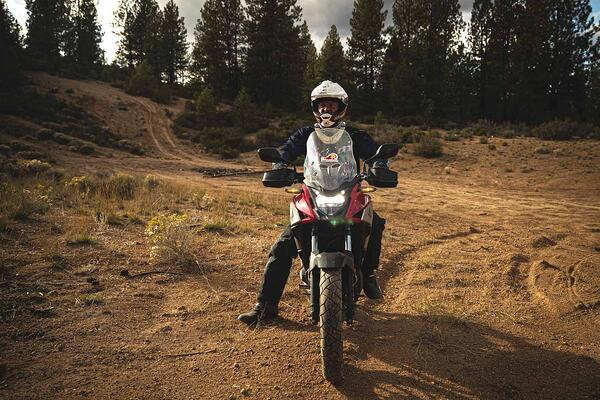 Rider on a Honda Cb500x finishing off a day of hard trail riding.