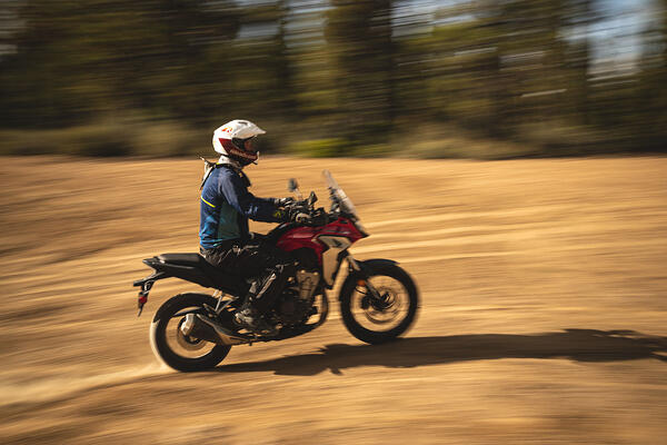 Eric riding fast while wearing the Shoei Hornet X2 Dual Sport helmet