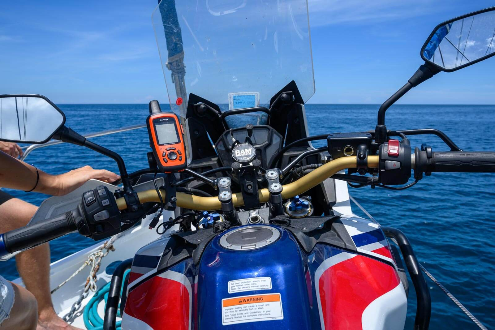 inreach_africa_twin_motorcycle_boat_taxi