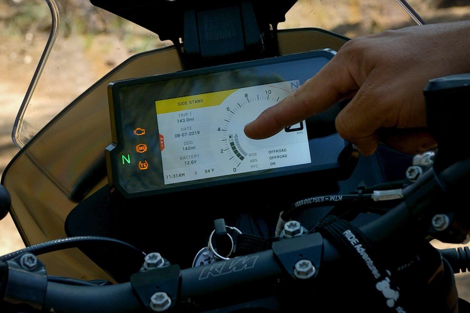 Eric points out the KTM 790's half fuel gauge