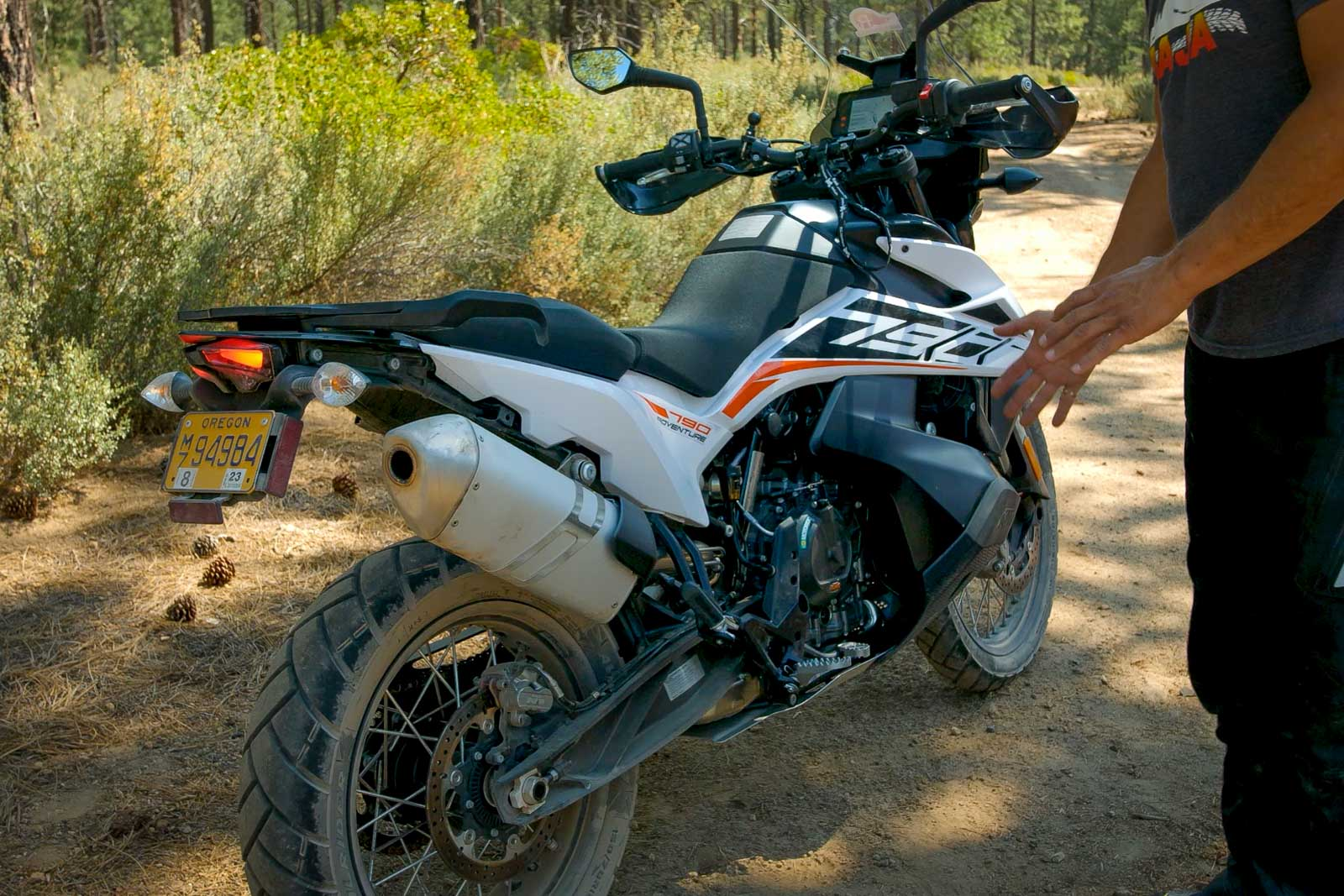 Eric pointing out the wheelbase on the KTM 790 Adventure