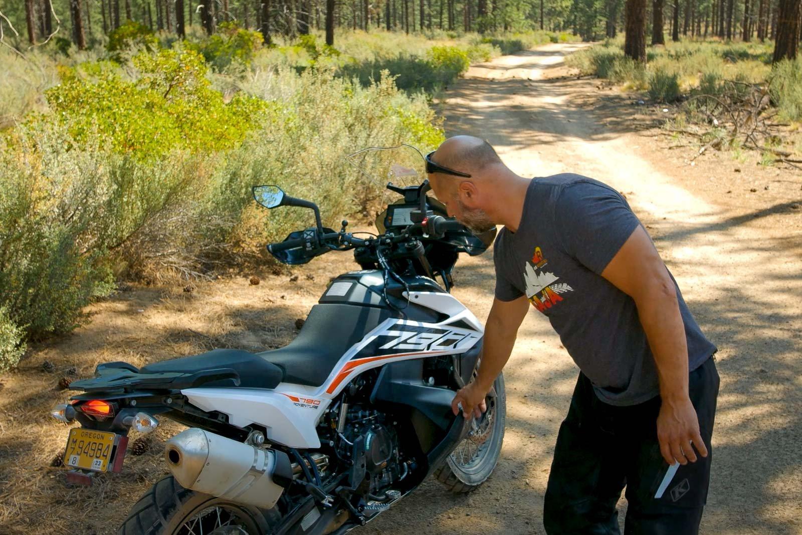 Eric points out the KTM 790's low slung fuel tank