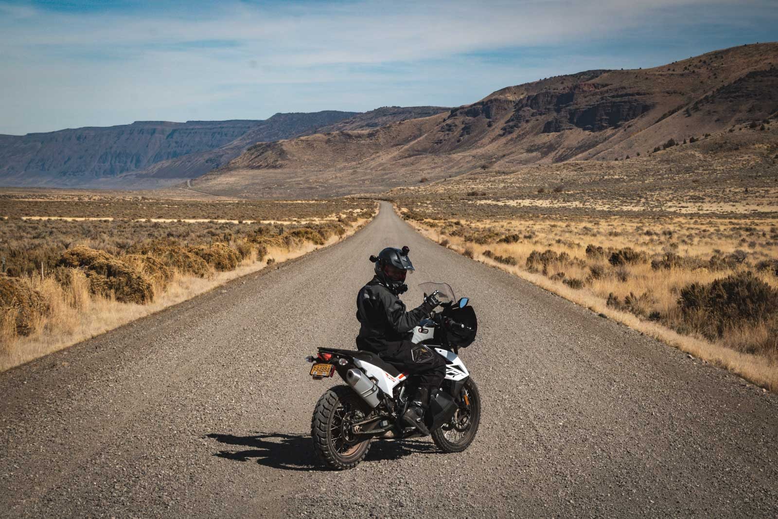 Garrett riding the KTM 790 Adventure out by Hart Mountain