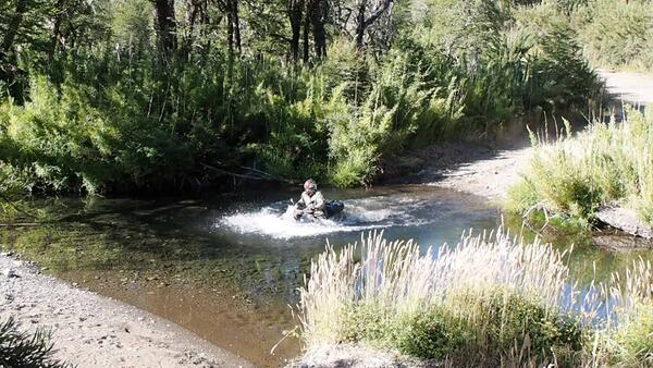 Adventure rider does a river crossing to find out it was more like a 6 foot pool.