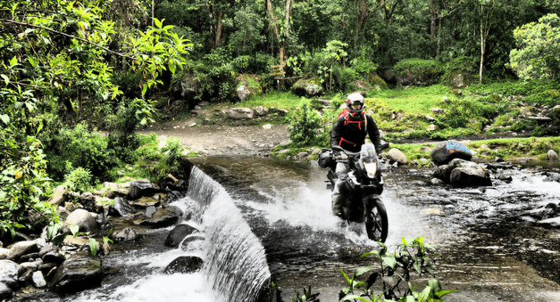 adventure riding river crossing Colombia