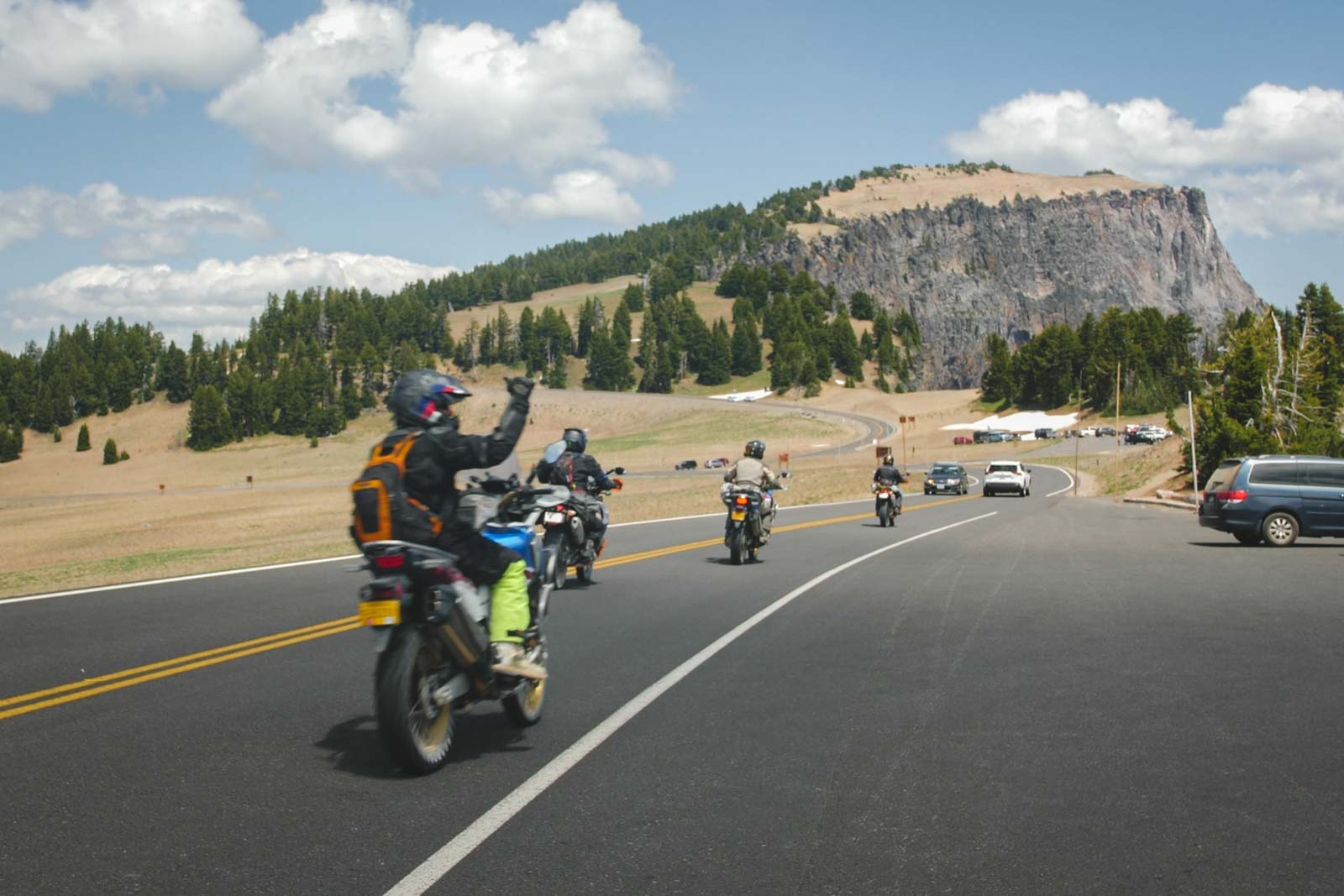 adv-rider-sends-the-shaka-in-crater-lake-national-park-on-adventure-motorcycle-tour-oregon